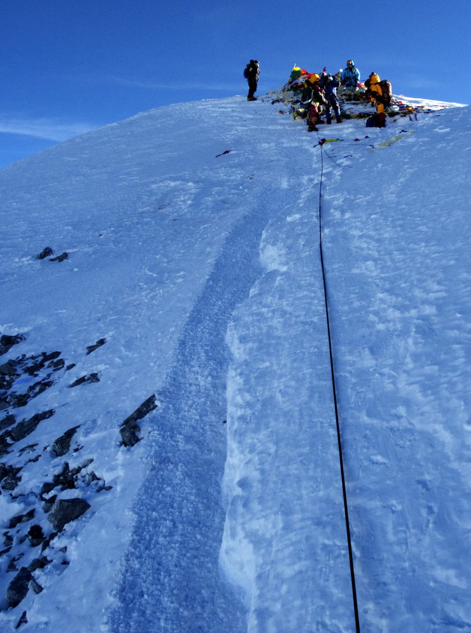 Climbers rest on the summit of Mount Everest in May.