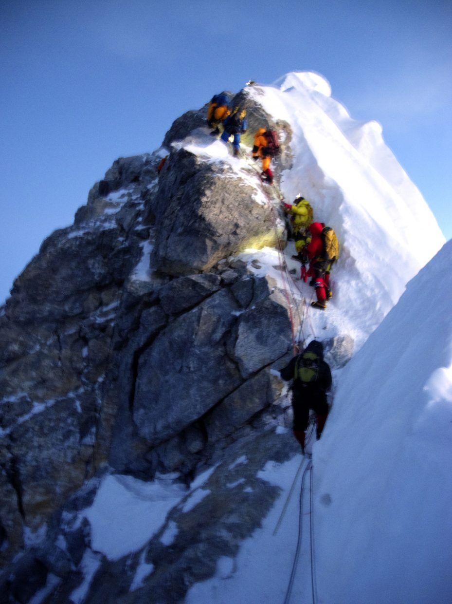 Climbers make their way over the South Summit of Mount Everest. The difficult landmark is only one among many on the way to the actual summit.