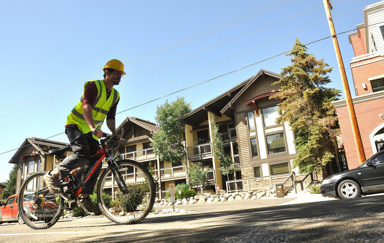 Guilhem Malichier, a specialist with ECO counter, tests out the new bike counter the Colorado Department of Transportation installed on Yampa Street to count bikes on the roadway.