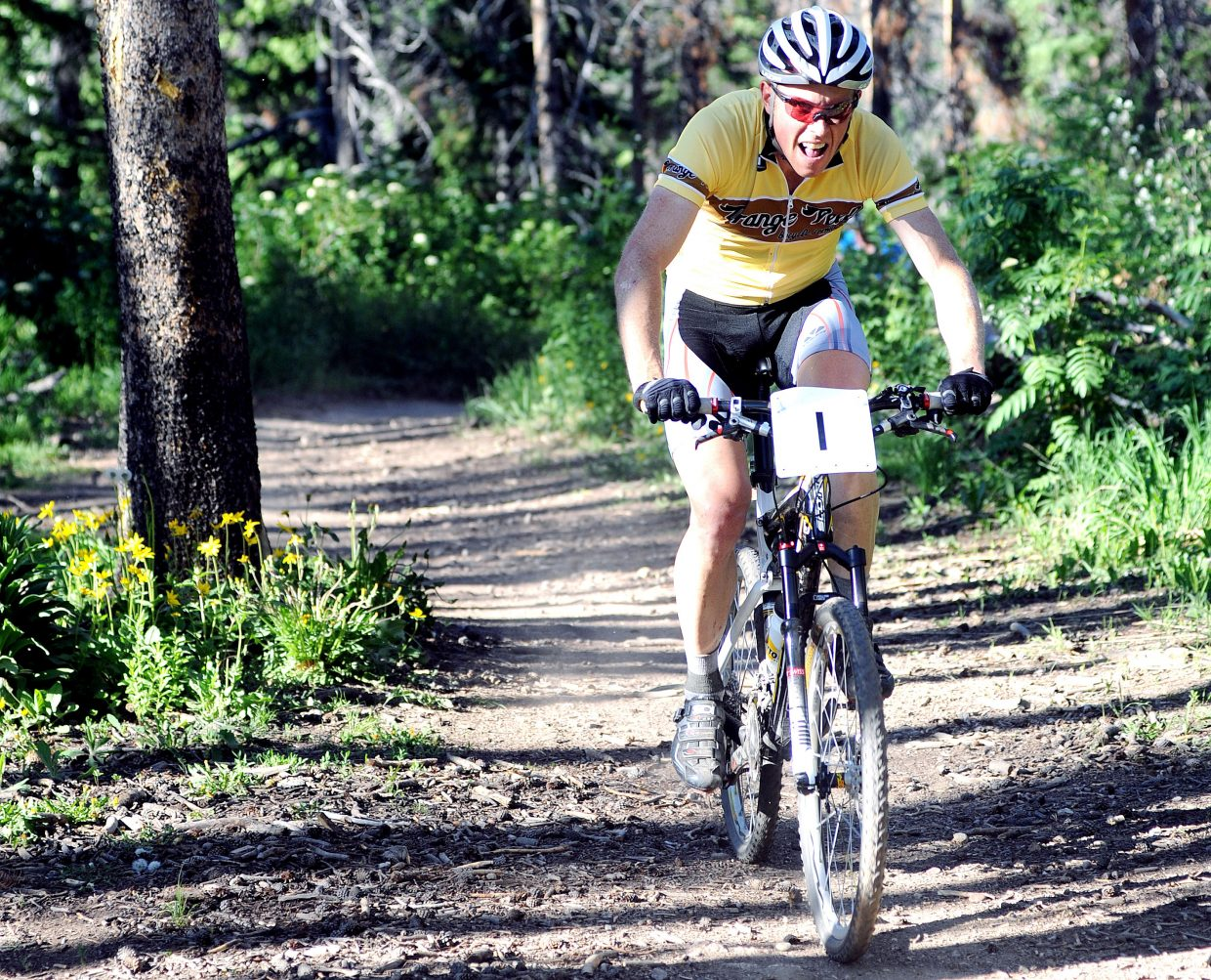 Barkley Robinson pedals through the woods Wednesday during the Thunderhead Hill Climb Town Challenge race on Mount Werner. Robinson won the men's division of the race.