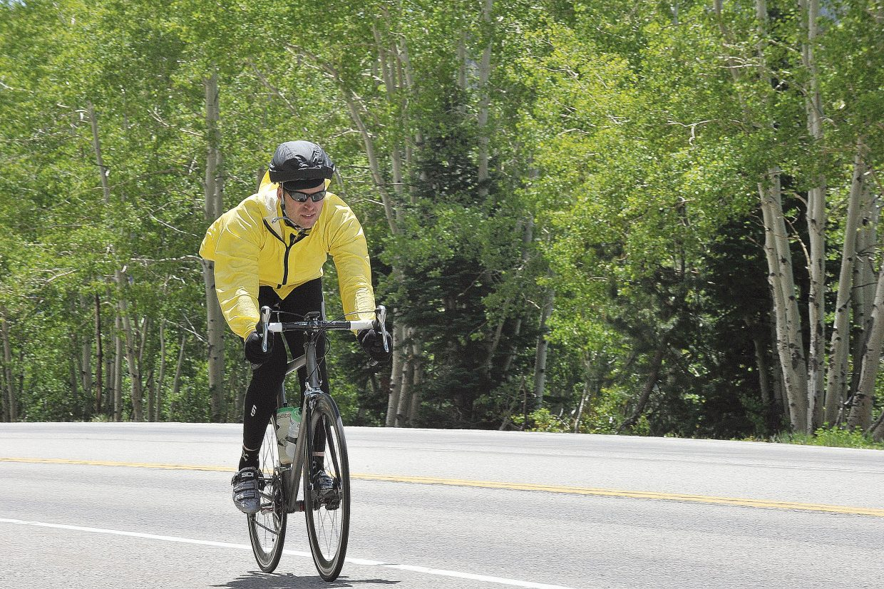 A cyclist rolls down Rabbit Ears Pass on U.S. Highway 40 during the Bike Tour of Colorado on Tuesday afternoon. The cyclists in the tour made the 80-mile journey from Granby over Rabbit Ears Pass and into Steamboat Springs on Tuesday. On Wednesday they will head to Glenwood Springs.