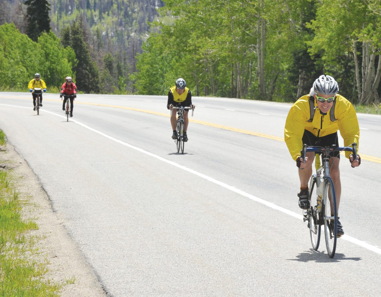 Cyclists roll down Rabbit Ears Pass on U.S. Highway 40 during the Bike Tour of Colorado on Tuesday afternoon. The cyclists in the tour made the 80-mile journey from Granby over Rabbit Ears Pass and into Steamboat Springs on Tuesday. On Wednesday they will head to Glenwood Springs.