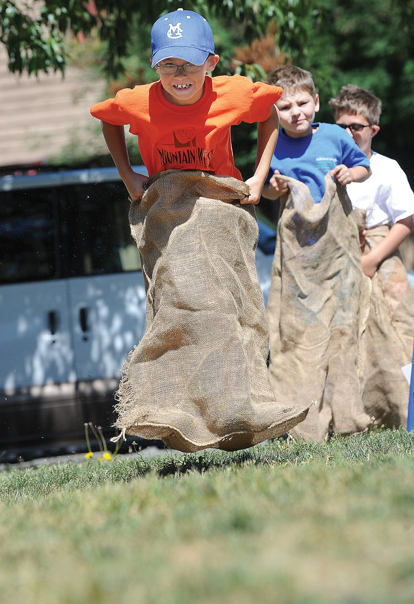 Forrest Siminoe takes part in the potato sack race Friday morning during Olympic Day at the Boys & Girls Club of Northwest Colorado. Members from Steamboat Springs and Craig joined to participate in races and team-building activities. Olympic Day highlighted the benefits of physical activity and a healthy lifestyle.