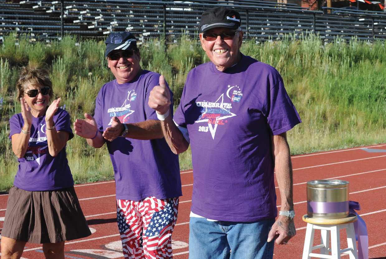 Cancer survivor Donald Walling gives a thumbs-up to the delight of fellow survivors Bill McKelvie and Anita Handing during the annual Relay For Life fundraiser.