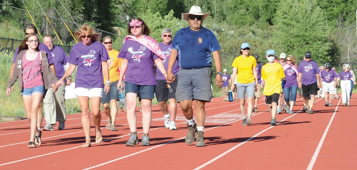 Survivors complete a lap Friday evening around the Steamboat Springs High School track during the annual Relay For Life fundraiser. The proceeds go to the American Cancer Society.
