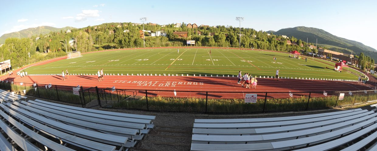 Luminaries and walkers circle the Steamboat Springs High School athletic field Friday evening as part of the Relay For Life fundraiser. The money raised goes to the American Cancer Society.