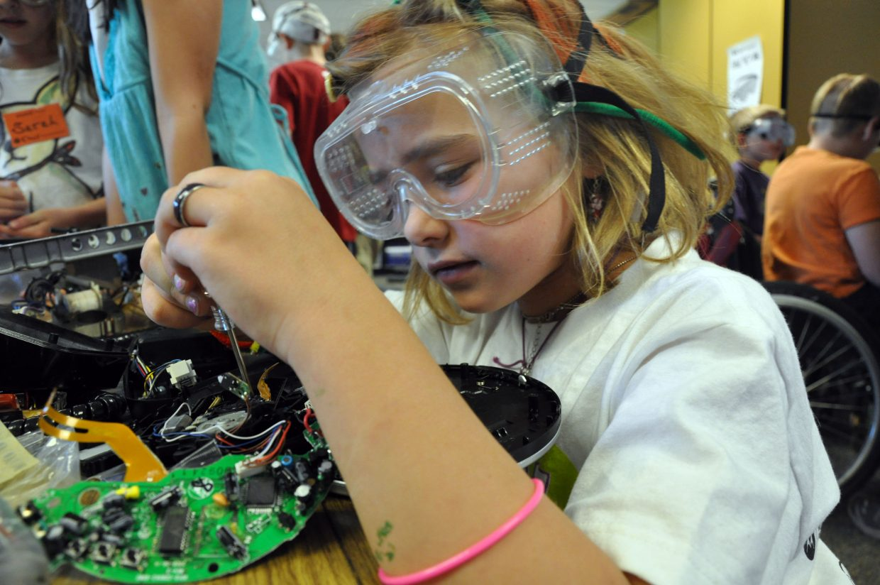 Julia McCarthy works in Camp Invention's Edison's Worshop on Wednesday at Strawberry Park Elementary School. McCarthy was one of 115 students to partcipate in the weeklong science camp