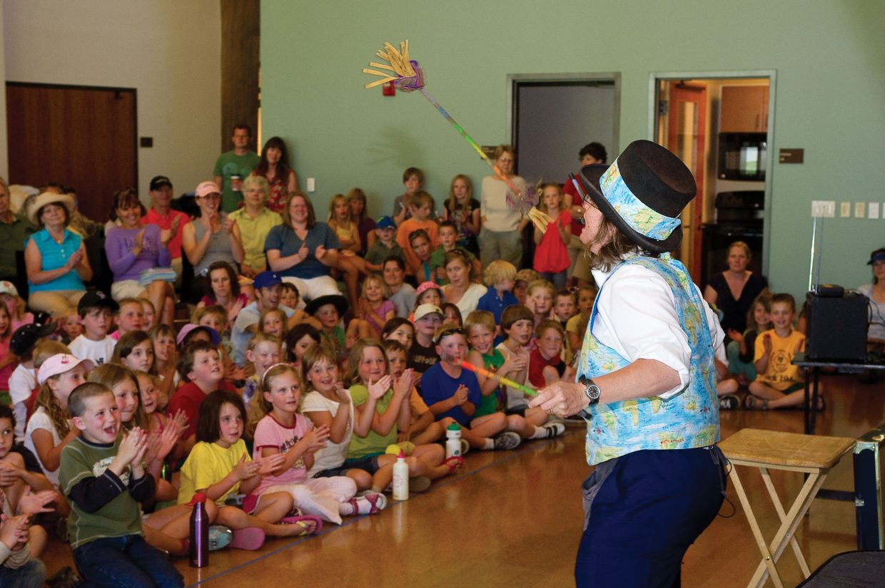 Ann Lincoln juggles for the audience during Wednesday's magic, juggling and comedy show in Library Hall at the Bud Werner Memorial Library on Wednesday afternoon. The show was free and is part of the Youth Services Department's One World, Many Stories summer reading program.