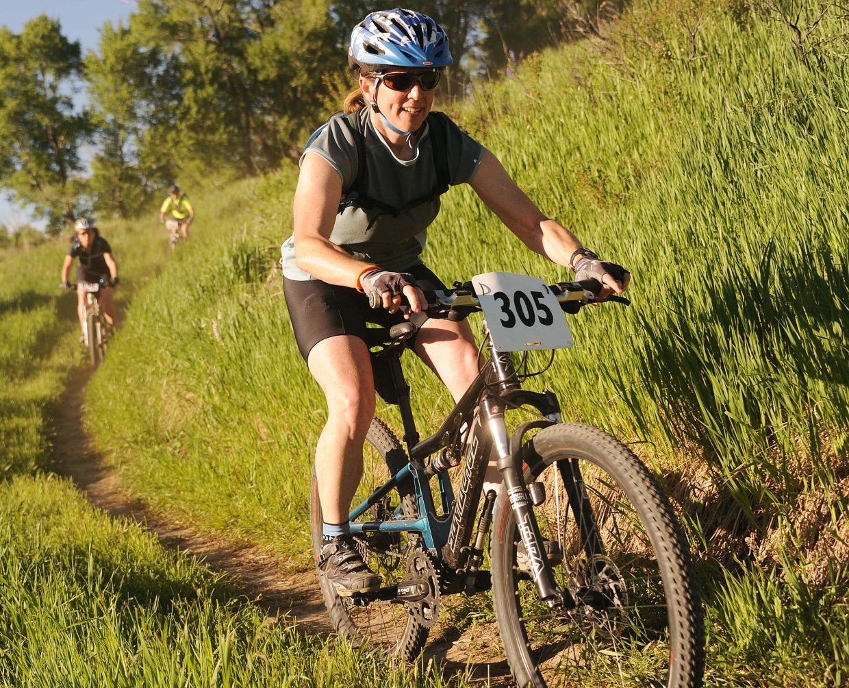 Melanie McDaniel leads a pack of riders Wednesday during a Town Challenge race at Marabou.