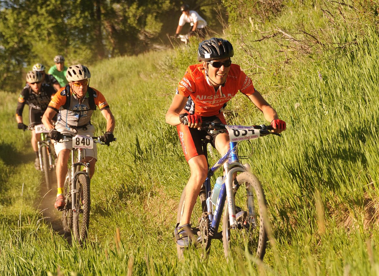 Tim Zander leads a pack of cyclists Wednesday during the Town Challenge Mountain Bike Race Series at Marabou. The event drew a record 228 athletes.