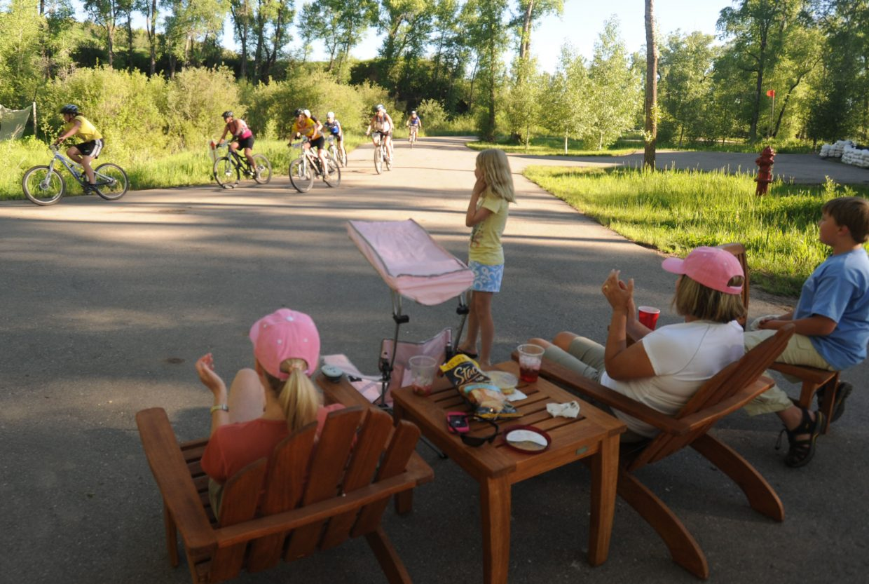 Cheryl Durham, her daughter Anna Grace Durham and their guests, Page Sobek and David Sobek cheer on racers Wednesday at Marabou Ranch.