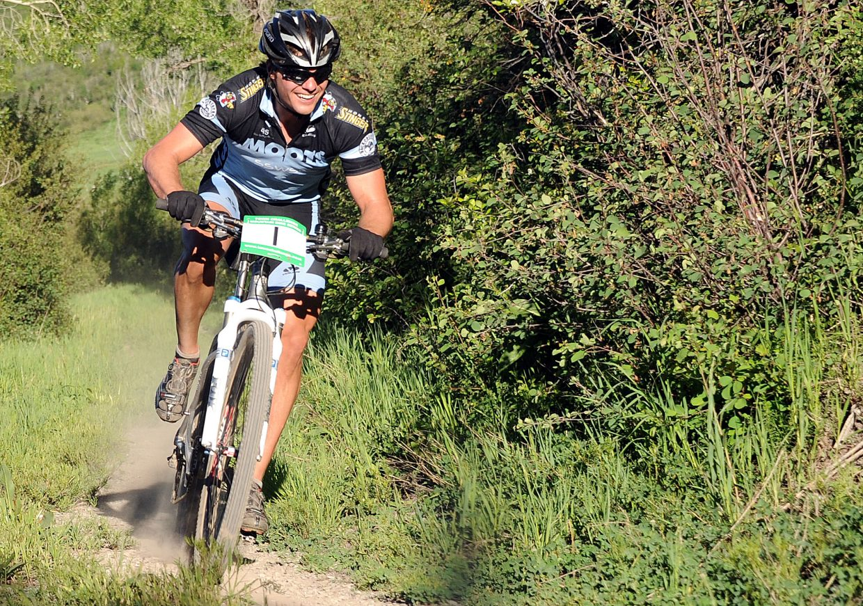 Brad Bingham races down the trail during Wednesday's Town Challenge race at Marabou. Bingham won the men's race while Kelly Boniface was the top woman, the pair pulling off victories for the second race in a row.