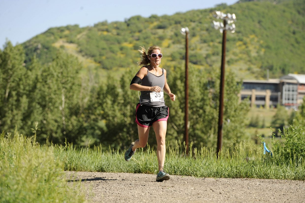 Michelle Barnes competes Saturday in the Steamboat Springs Running Series Howelsen Hill 8-Miler. A record number of people participated in the race, which was a fundraiser for Routt County Riders. Harry Niedl and Tammy Jacques won the 8-mile race. Tyler Scholl and Tabor Scholl won the 4-mile race.