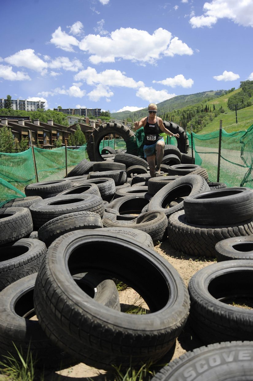 Lauren Jenkins runs through tires during the Steamboat Mad Mud Run on Saturday at Steamboat Ski Area.