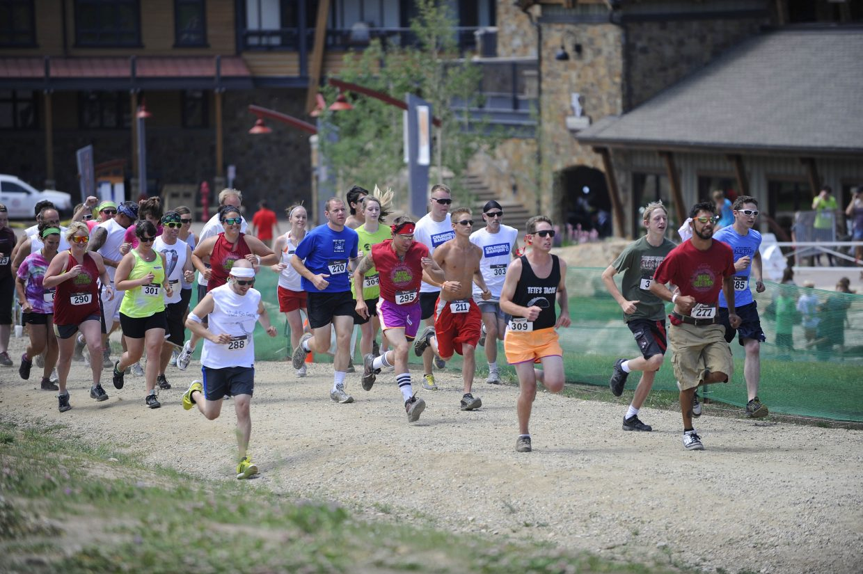Participants leave the starting line during the Steamboat Mad Mud Run on Saturday at Steamboat Ski Area.