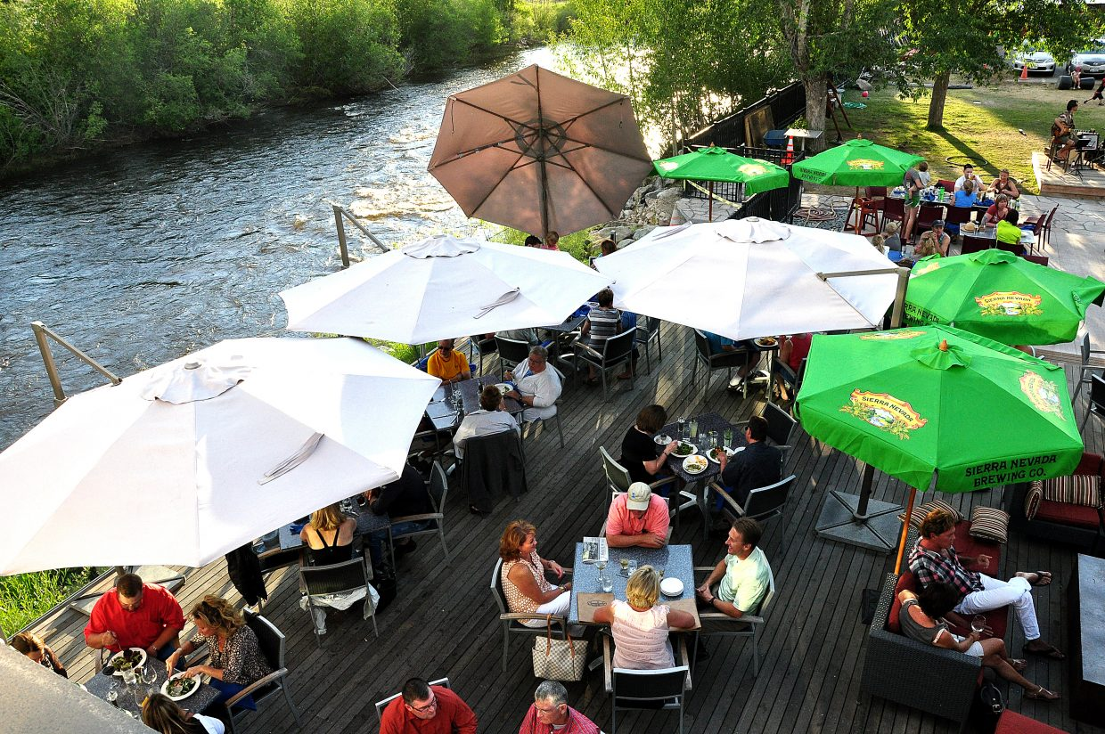 Diners enjoy the riverfront patio at Sweetwater Grill. Proponents of the Yampa River promenade say it will be a tourist draw year round, and the project will be matched by private investment from downtown business owners.