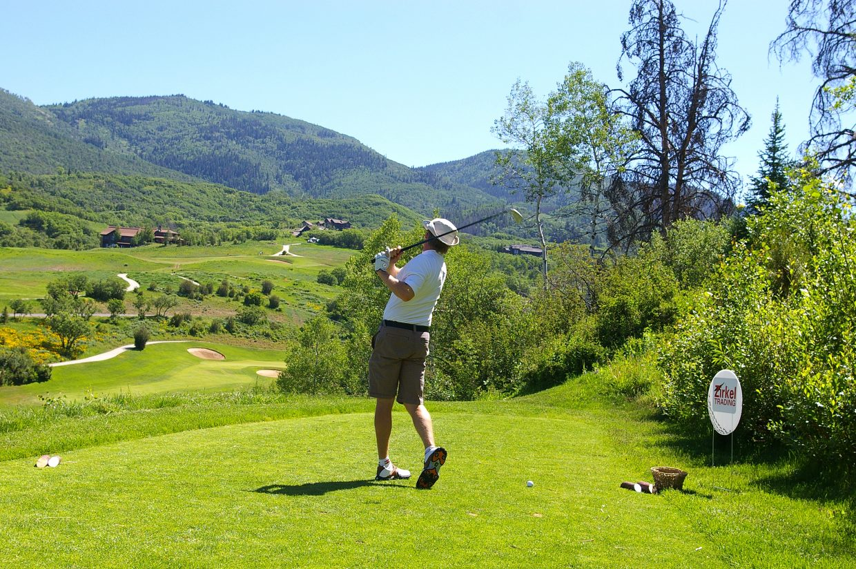 Randy Nelson tees off on the sixth hole Saturday at Catamount Ranch & Club during the Ski Town USA Golf Classic. Nelson and his teammates — Buddy King, Butch Boucher and Steve Dodson — shot a 263 during the two-day tournament.