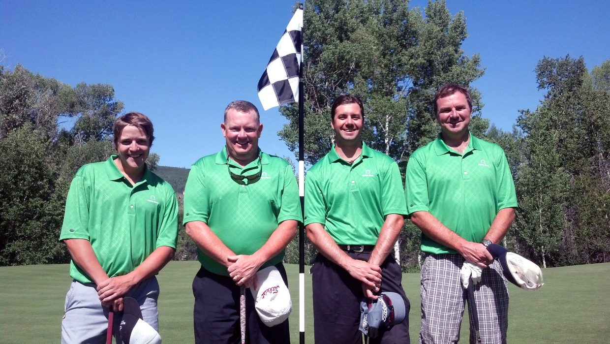 The Alpine Bank team of Glen Traylor, Tom Henninger, Jeremy Behling and Geoff Coon won the top flight of the 2013 Ski Town USA Golf Classic. The team, shown together on the fifth hole at Rollingstone Ranch Golf Club, shot 44 under par over two days to win.
