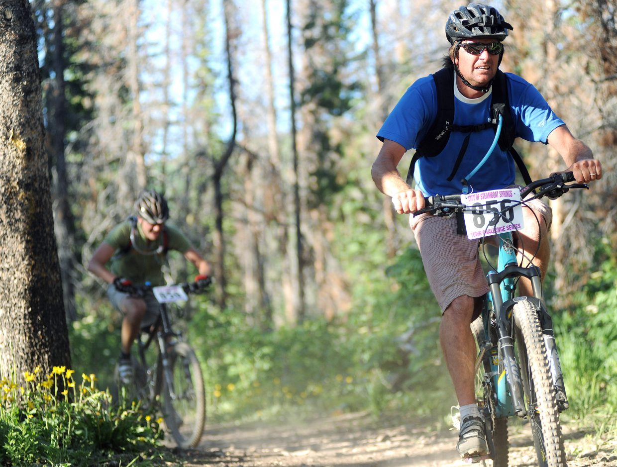 Darren Robinson rides up Mount Werner on Wednesday during the Town Challenge Mountain Bike Race Series.