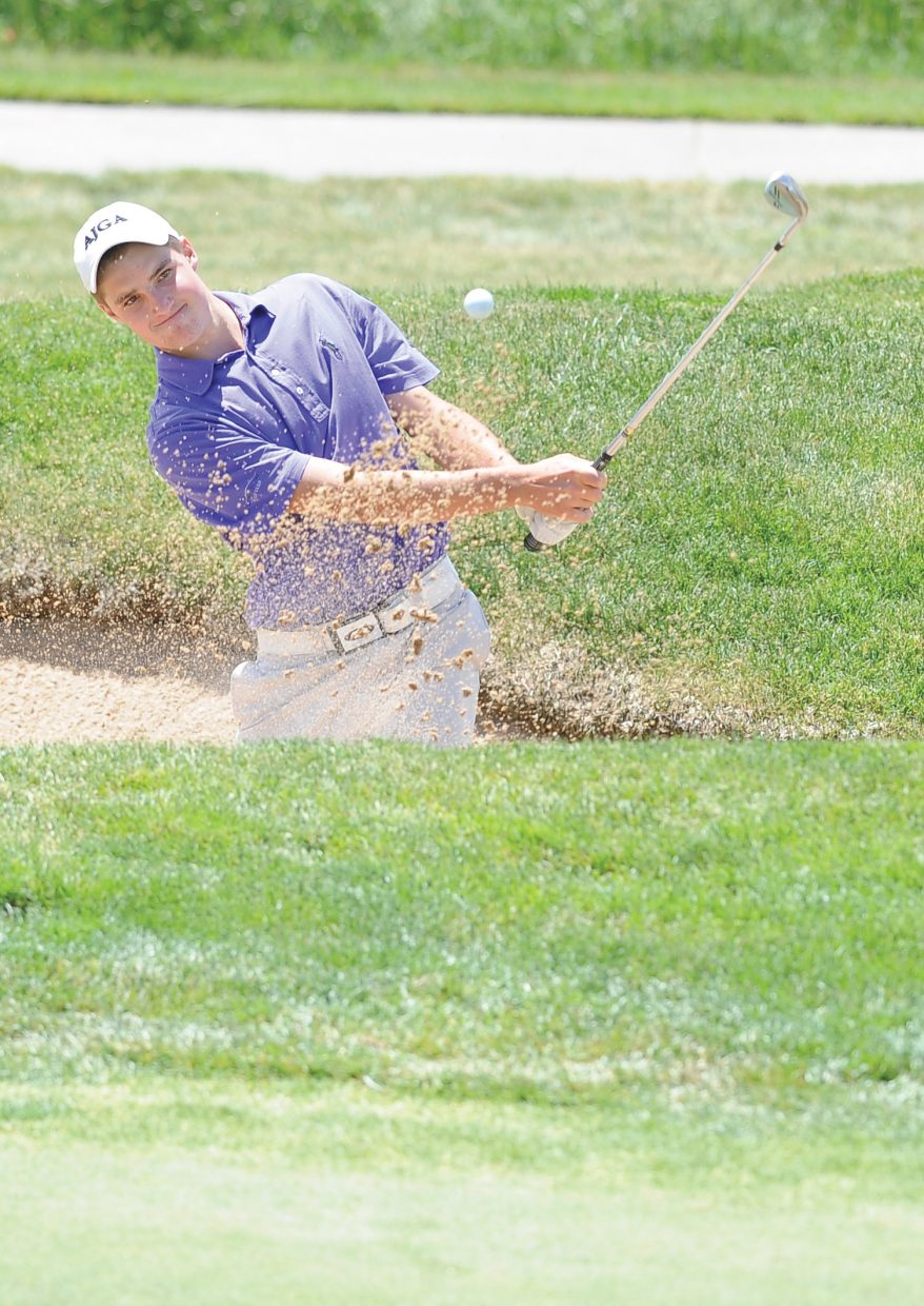Englewood golfer Jake Staiano chips out of the sand trap at Haymaker Golf Course on Tuesday afternoon during the Colorado Junior Golf Association's Haywhacker golf tournament. Staiano and Kyler Dunkle, of Douglas County, finished the two-day tournament tied at 146. Staiano shot par on the first hole of a sudden-death playoff to win the tournament. Columbine's Holly Schaefer won a playoff to earn the girls ages 14 to 18 title, and Denver's Natasha McClain did the same in the girls 11 to 13 division. The two-day event took place at Haymaker and Rollingstone Ranch Golf Club and drew 160 of the top junior players in the state to Steamboat Springs.
