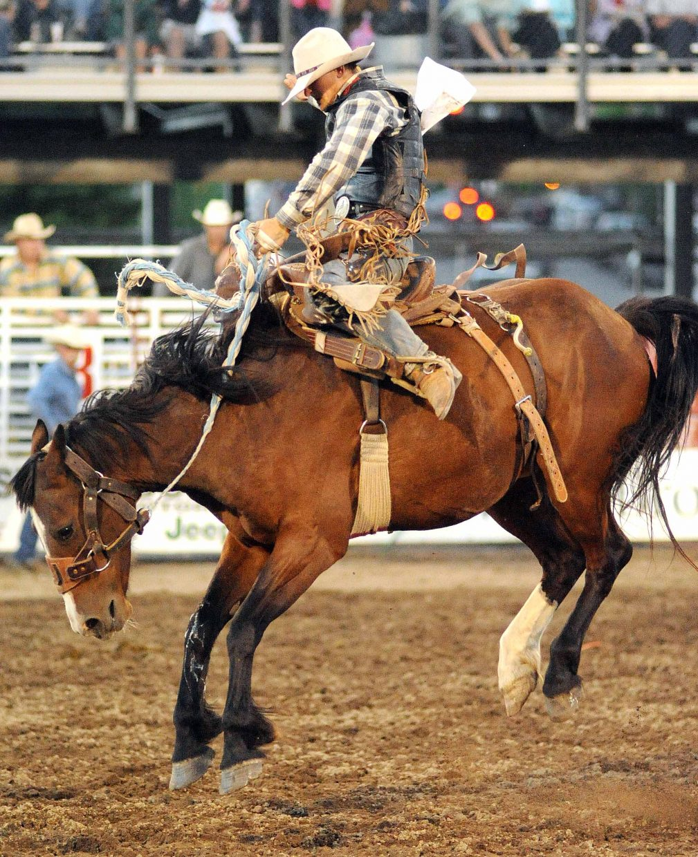 Steamboat Springs Pro Rodeo Series at the Brent Romick Rodeo Arena, 6:30 p.m.: Events include team roping, bronc riding, clowns, barrel racing and bull riding. Barbecue starts at 5 p.m. and live entertainment goes on at 5:15 p.m. Fireworks show follows rodeo. FREE for children 6 and younger, $10 for youths ages 7 to 15, $20 for adults. 970-879-1818 or www.steamboatprorodeo.com. 401 River Road.(Photo: Loncey Johnson rides in 2011.)