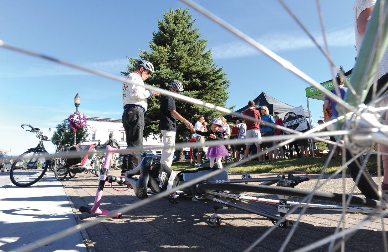 Cyclists gather on the courthouse lawn during the Bike to Work Day breakfast Wednesday morning.