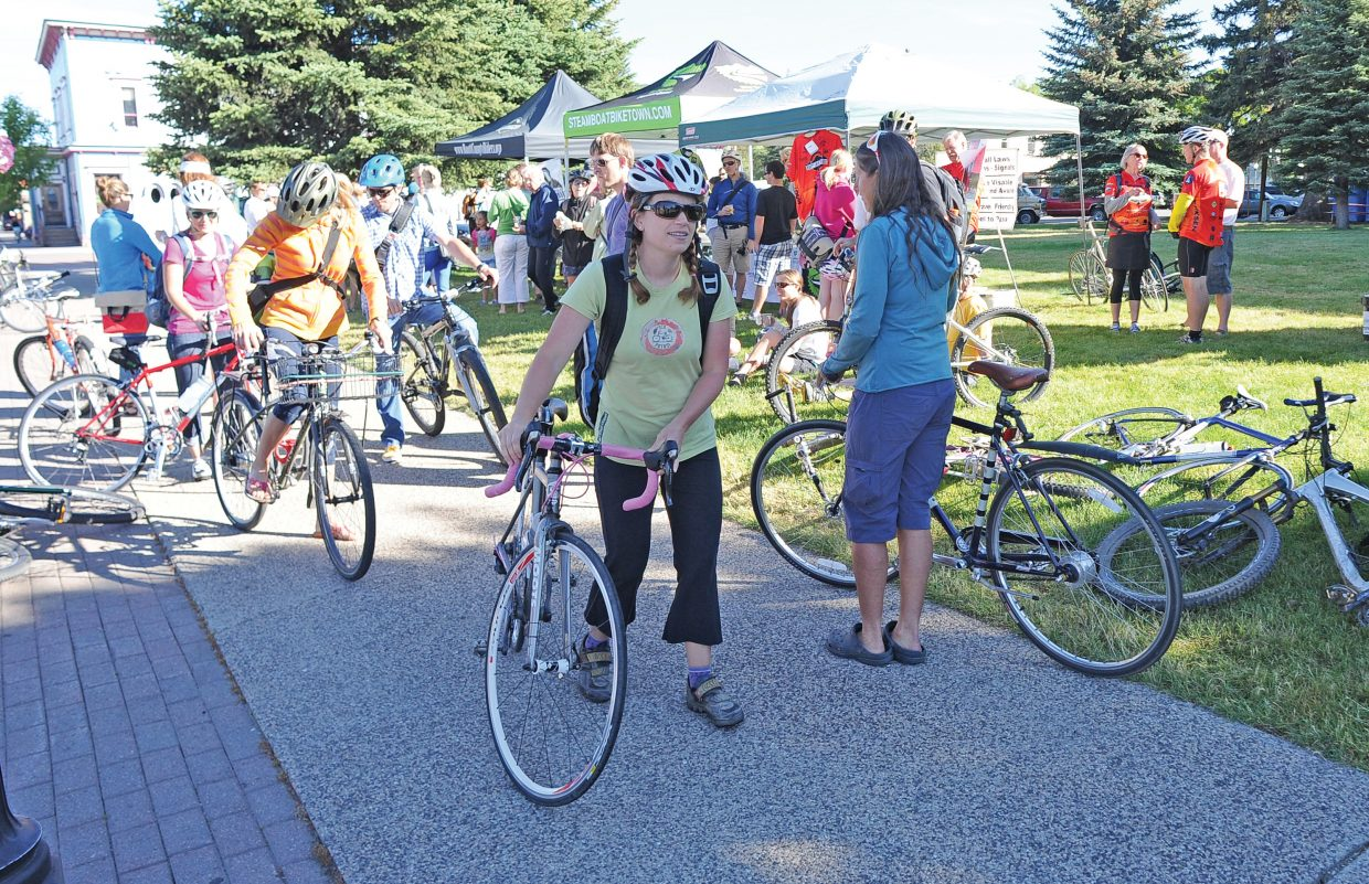 Laura Soard heads to work after enjoying breakfast on the Routt County Courthouse lawn during the Bike to Work Day breakfast.