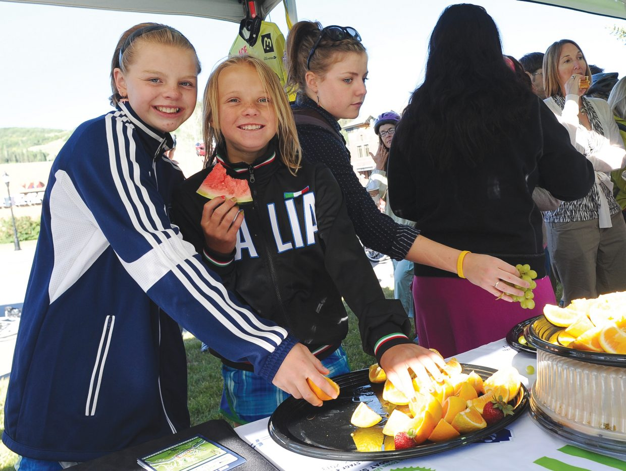 Shilo Lottes, left, and Maddie Craigen enjoy breakfast on courthouse lawn during the Bike to Work Day breakfast Wednesday morning. The breakfast is organized by Routt County Riders and is the culmination of Bike to Work Month.