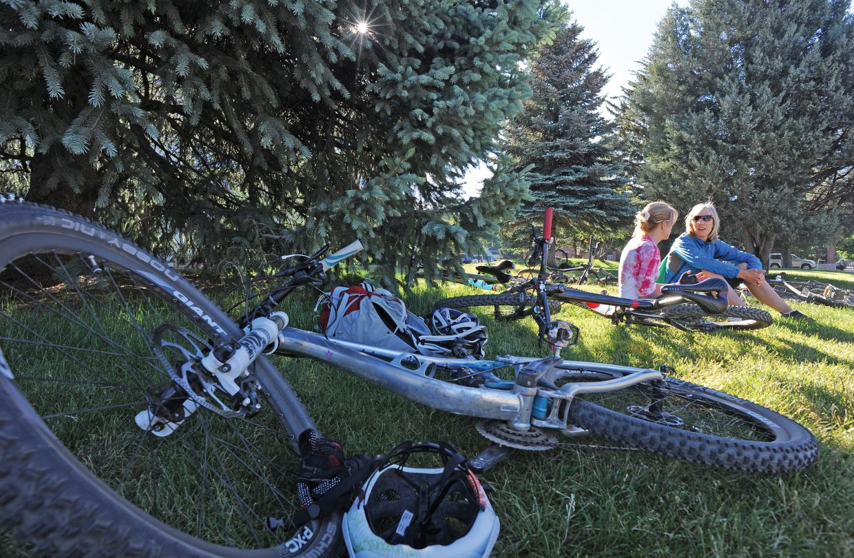 Marti Irish, left, and Emily Lovett enjoy a little breakfast conversation on the Routt County Courthouse lawn during the Bike to Work Day breakfast Wednesday morning. The breakfast is organized by Routt County Riders and is the culmination of Bike to Work Month. The day included a free grab-and-go breakfast with items donated by local restaurants and other businesses.