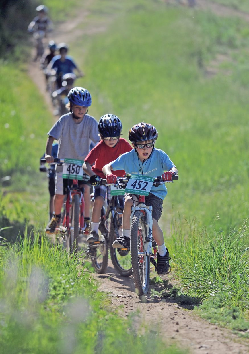 Seven-year-old Sal Malone makes his way up a hill during Wednesday night's Quarry Mountain XC Town Challenge mountain bike race. Sal was racing in the 7- to 8-year-old division of the race.