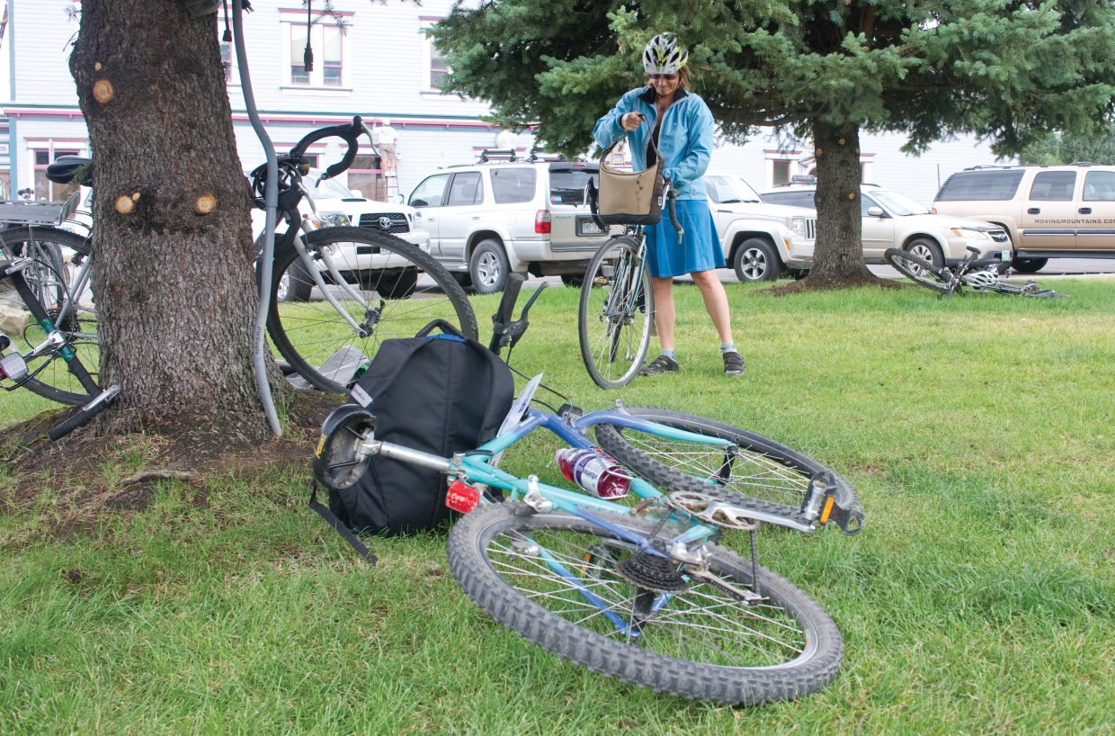 Sandy Kent arrives at the Bike to Work Day breakfast Wednesday morning on the Routt County Courthouse lawn. The event, which was put on by Routt County Riders and Honey Stinger, offered cyclists who elected to bike to work a free breakfast.