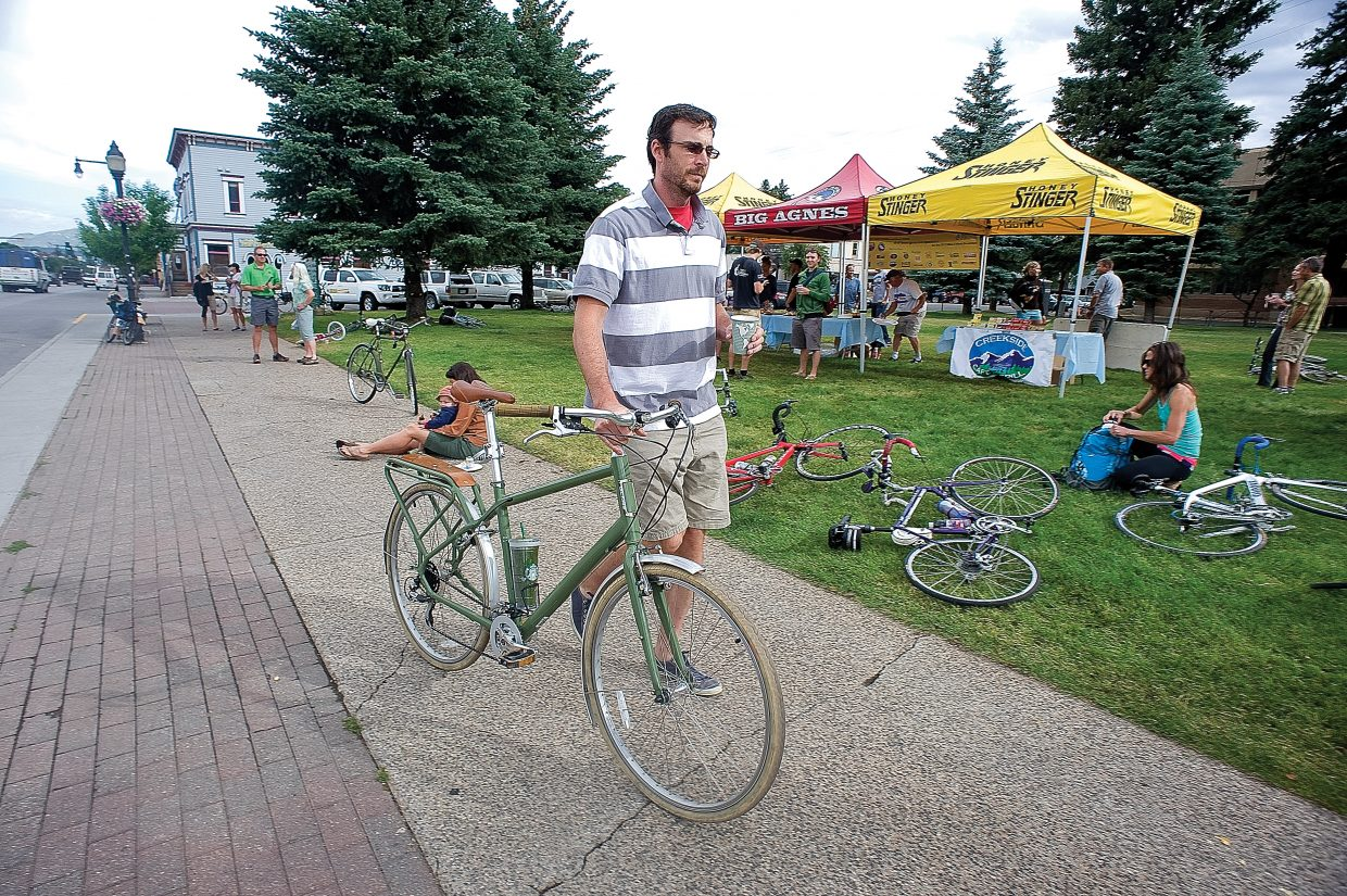 Local cyclist Paul Decrette heads to work after stopping by the Bike to Work Day breakfast Wednesday morning on the Routt County Courthouse lawn. The event, which was put on by Routt County Riders and Honey Stinger, offered cyclists who elected to bike to work a free breakfast.