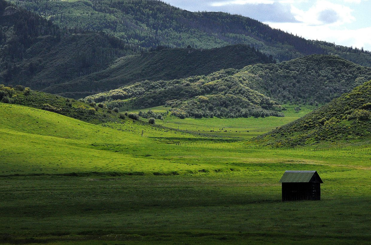 Light skirts around a lone shed on a back road to North Routt County.