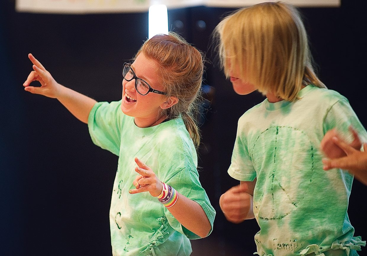 """Young actor Lauren Eck plays a member of the Green family in """"The Rainbow Connection"""" on Friday morning in Library Hall at Bud Werner Memorial Library. The play was written by Emily Stout for the Children's Theater Workshop."""