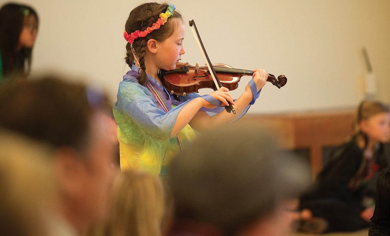 """Young performer Alena Rossi plays her violin in """"The Rainbow Connection"""" on Friday morning in Library Hall at Bud Werner Memorial Library."""