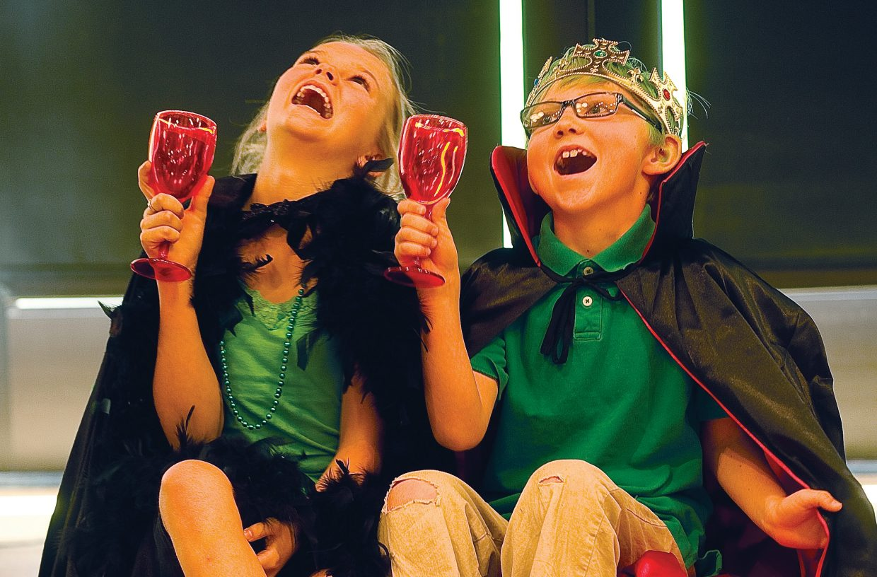 """Bruce Hayes plays the part of the Leprechaun King alongside Maya Kissane, the Leprechaun Queen, in the production of """"The Rainbow Connection"""" on Friday morning in Library Hall at Bud Werner Memorial Library."""