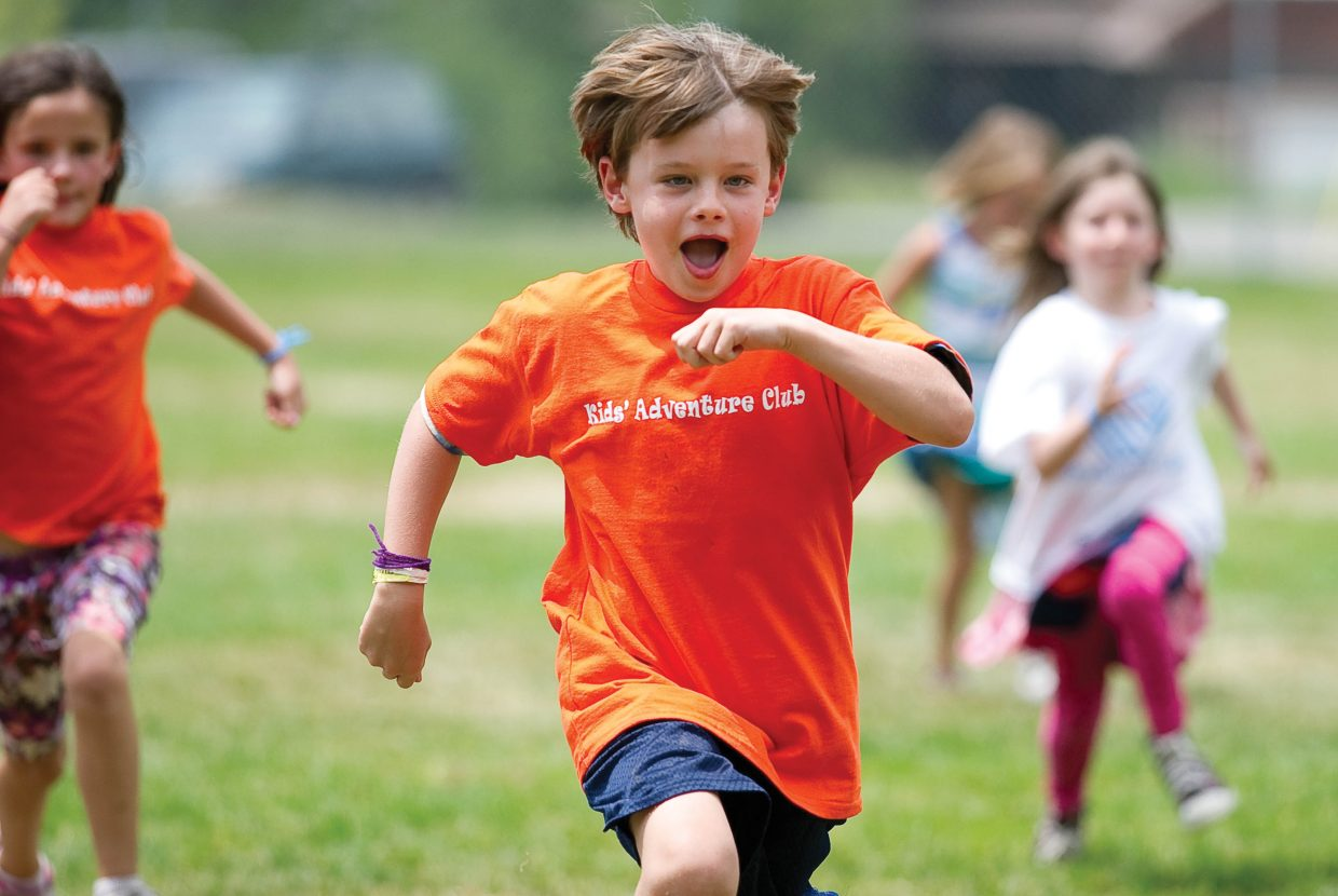 Third grader Bennett Curran races toward the finish line during the city's first Camp Olympics Wednesday afternoon at Soda Creek Elementary School. Children from different day care programs in Steamboat Springs and the surrounding area gathered at the elementary school and spent the day meeting Olympian Caroline Lalive and participating in activities.