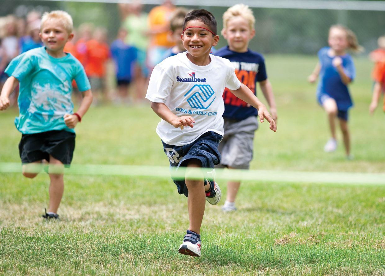 Jose Hernandez races toward the finish line during the city's first Camp Olympics Wednesday afternoon at Soda Creek Elementary School. Children from different day care programs in Steamboat Springs and the surrounding area gathered at the elementary school and spent the day meeting Olympian Caroline Lalive and participating in activities.