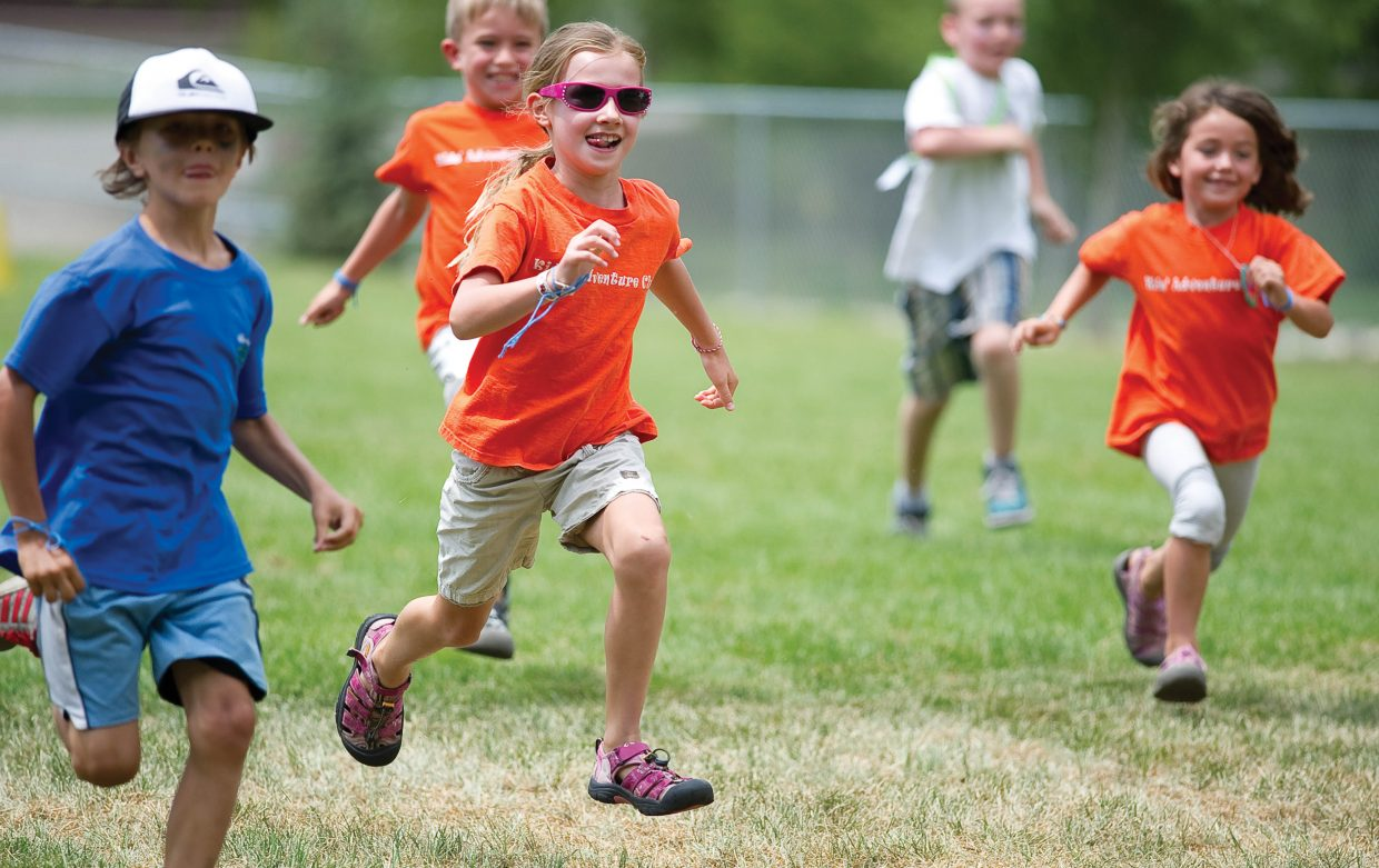 Elle Jones races toward the finish line during the city's first Camp Olympics Wednesday afternoon at Soda Creek Elementary School. Children from different day care programs in Steamboat Springs and the surrounding area gathered at the elementary school and spent the day meeting Olympian Caroline Lalive and participating in activities.