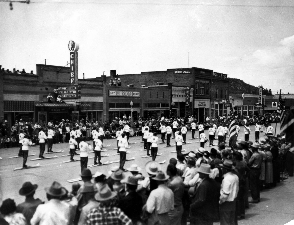 The 1950 Ski Band's skis are fitted with rollers in a Fourth of July test run for the band's appearance in the Lions Club Parade in Chicago that year.