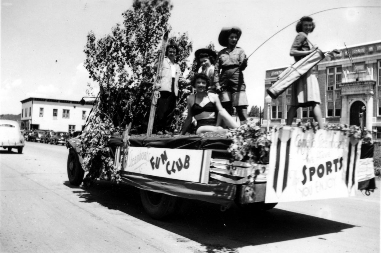 Ann Gooding, pictured in the bathing suit, rides on the Fun Club float July 4, 1947, through downtown Steamboat. In the background is the Routt County Courthouse.