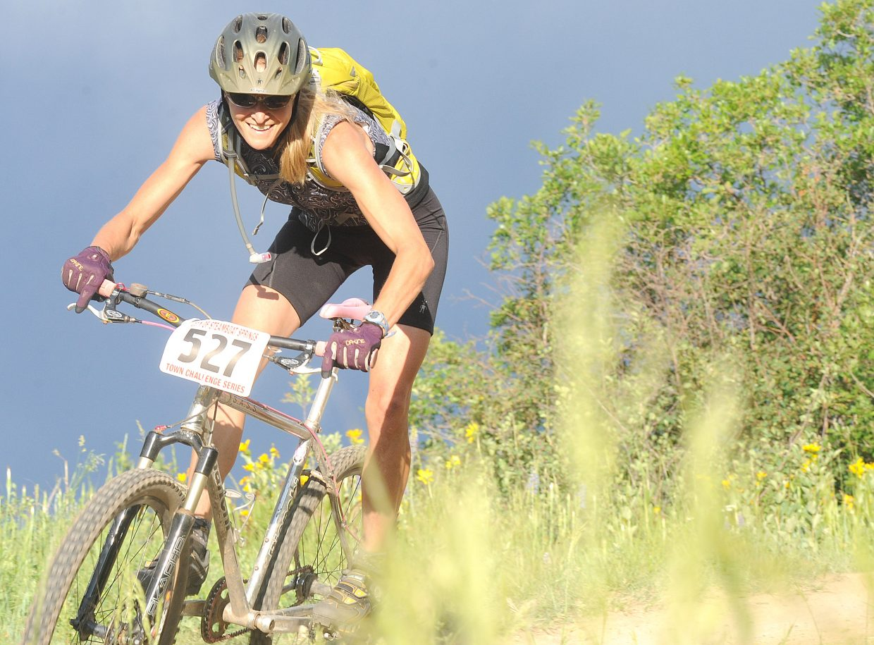 Marla Bailey, the lone rider in the women's singlespeed division, pulls around a corner in Wednesday's Town Challenge race on Emerald Mountain.