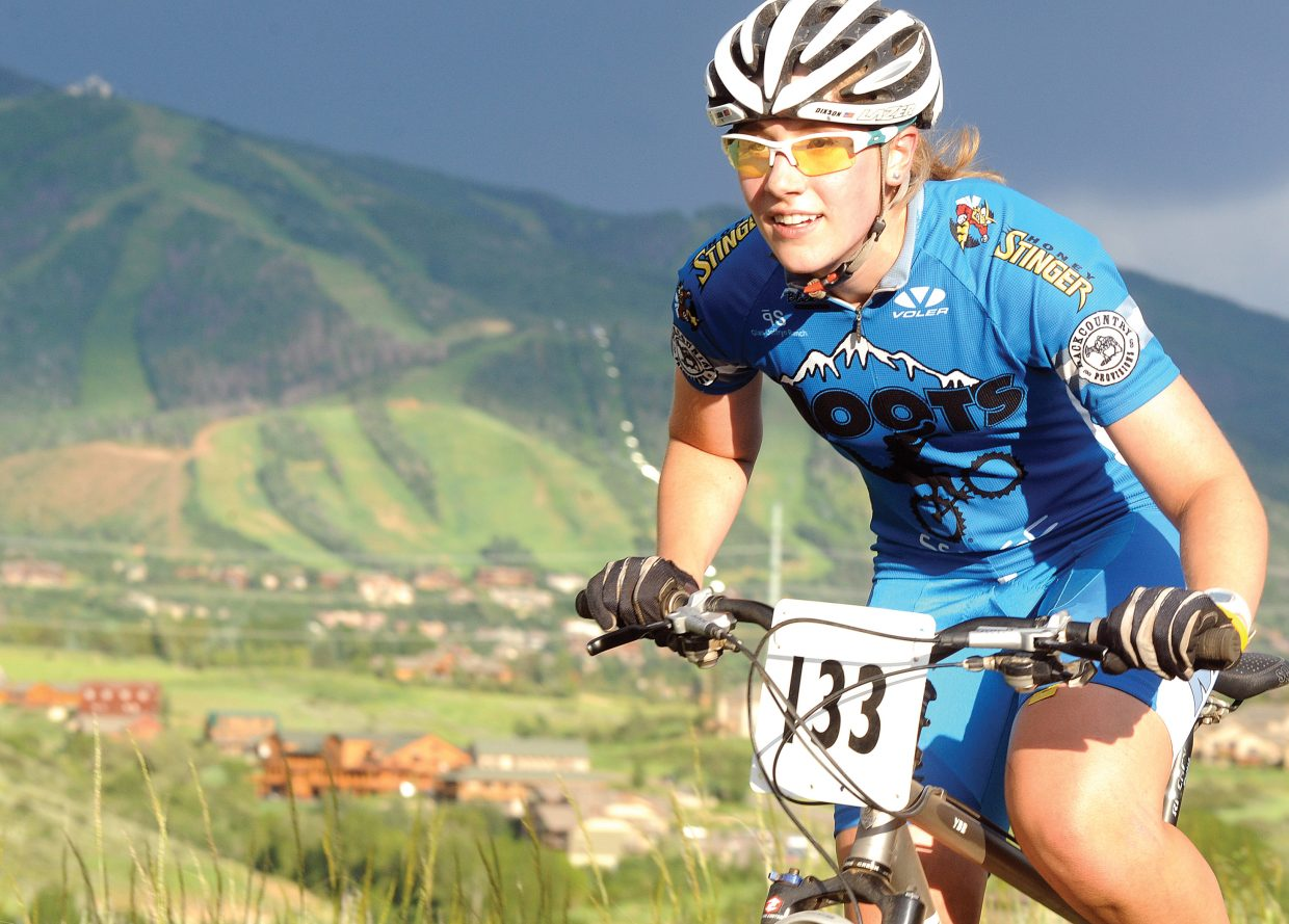 Linnea Dixson cruises down the trail Wednesday during the Town Challenge Mountain Bike Race Series in Steamboat Springs.