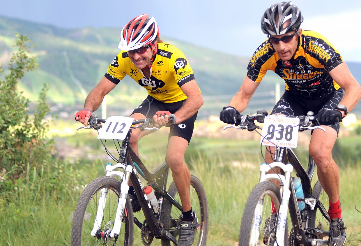 Ron Famiglietti and Ian Anderson dash toward the finish line Wednesday in the Town Challenge Mountain Bike Race Series event on Emerald Mountain. Anderson won the division, edging out Famiglietti by just 3 seconds.