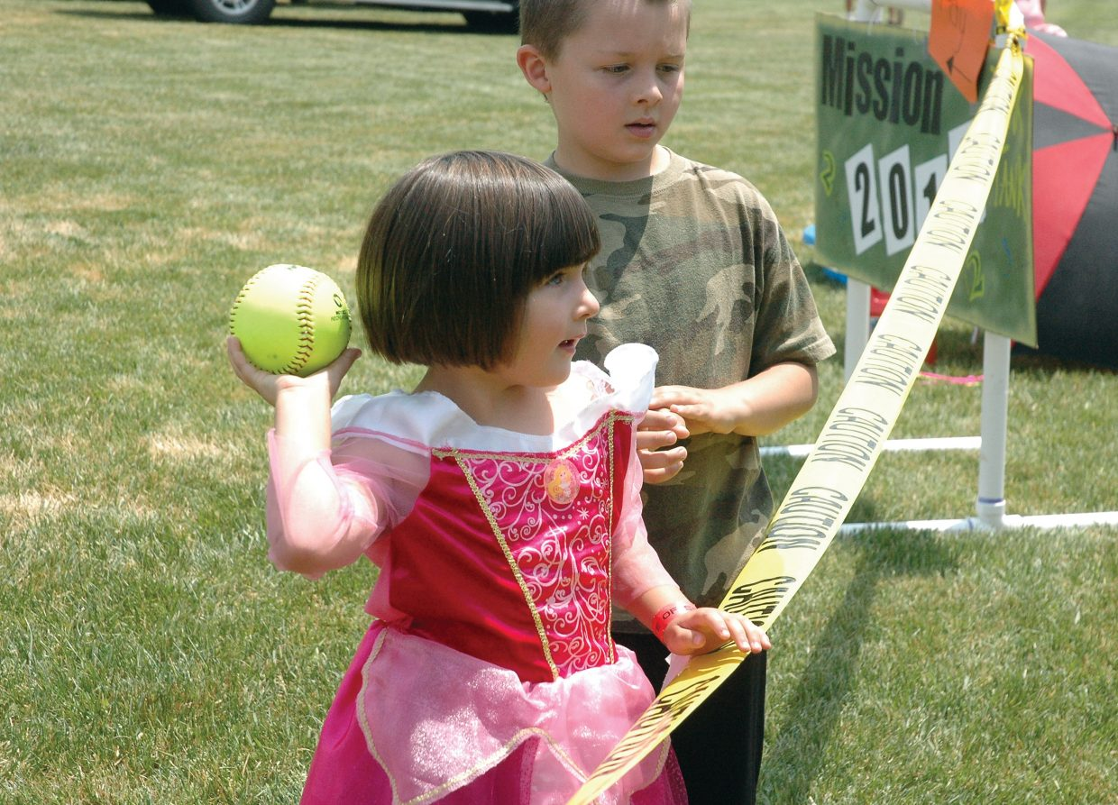 Dressed as a princess, 5-year-old Ryleigh Stahoviak aims a ball for the dunk tank at the annual Taste of South Routt celebration Saturday in Oak Creek.