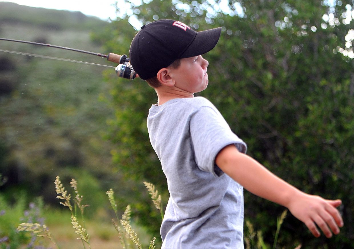 Ben Bogan, 9, casts far into Fetcher Pond on Sunday evening. Plenty cast a line into the Steamboat Springs body of water on what was a fine summer day. Bogan was accompanied by father Brian Bogan, and brother, James, 11.