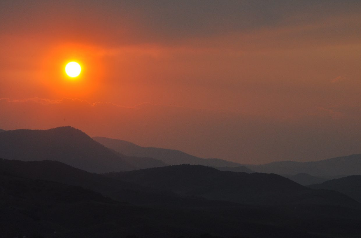 The sun sets behind a blanket of smoke Saturday just west of Steamboat Springs. Temperatures in Steamboat are forecast to reach the 90s for much of the week as the fire danger remains very high.