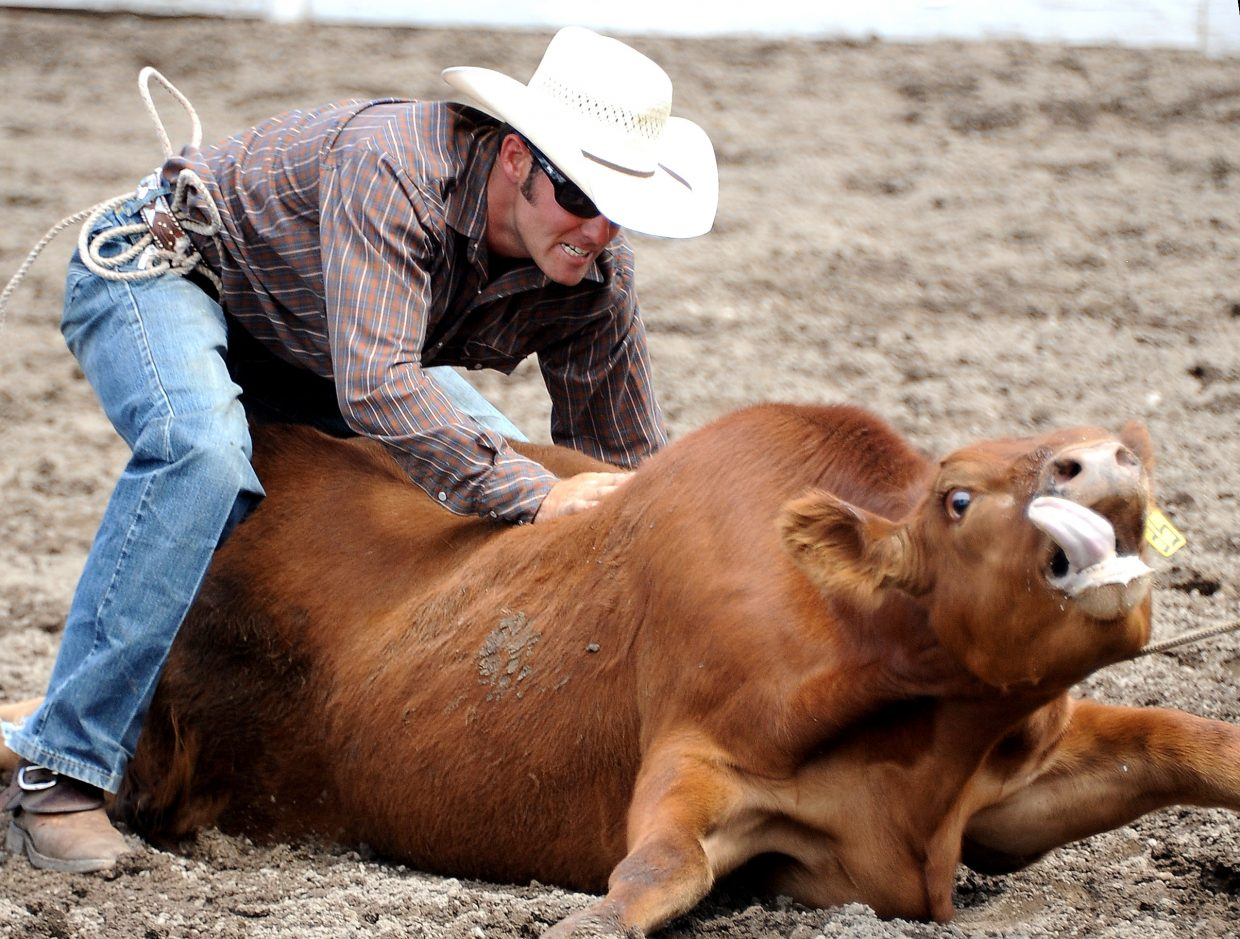 Pete Danco tackles a steer on Sunday during the ranch rodeo in Steamboat Springs.