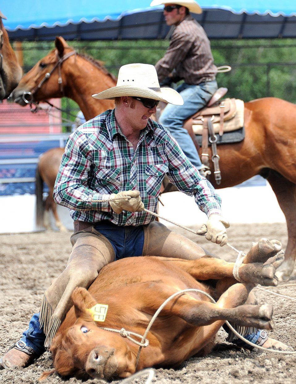 Whit Gates ties up a steer Sunday during the ranch rodeo in Steamboat Springs.