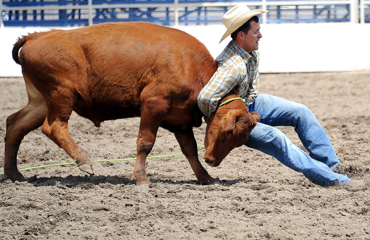 Luke Kelley wrestles a steer Sunday at the ranch rodeo in Steamboat Springs.